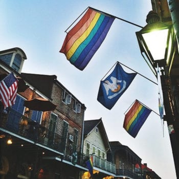 Rainbow flags hanging in the French Quarter, where there are plenty of ways to celebrate Pride Month in New Orleans.