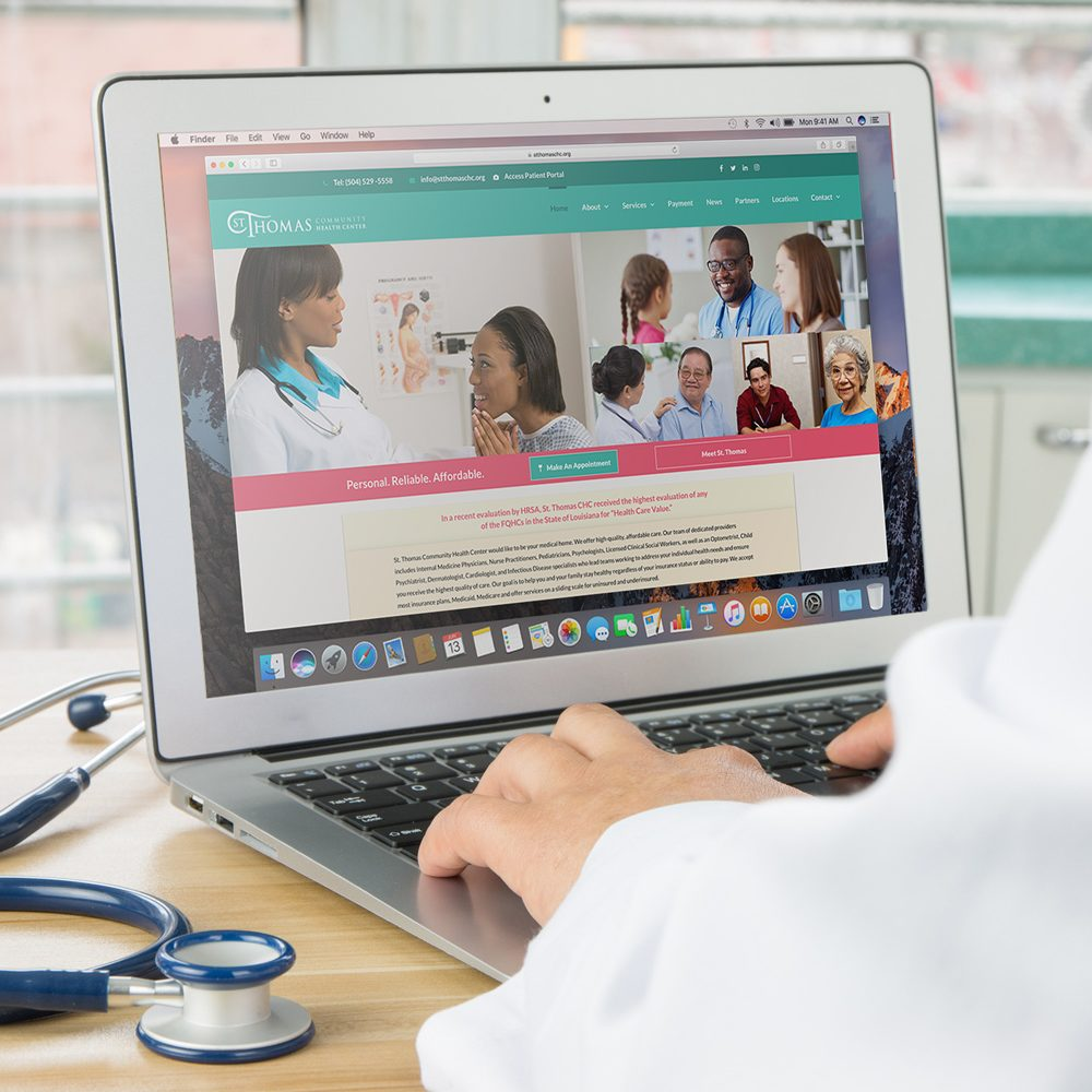 Doctor using St. Thomas' website on a laptop